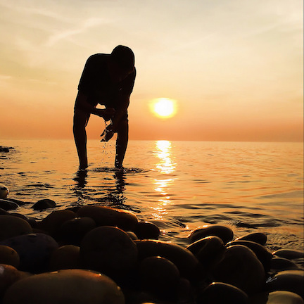 Joshua picks a rock